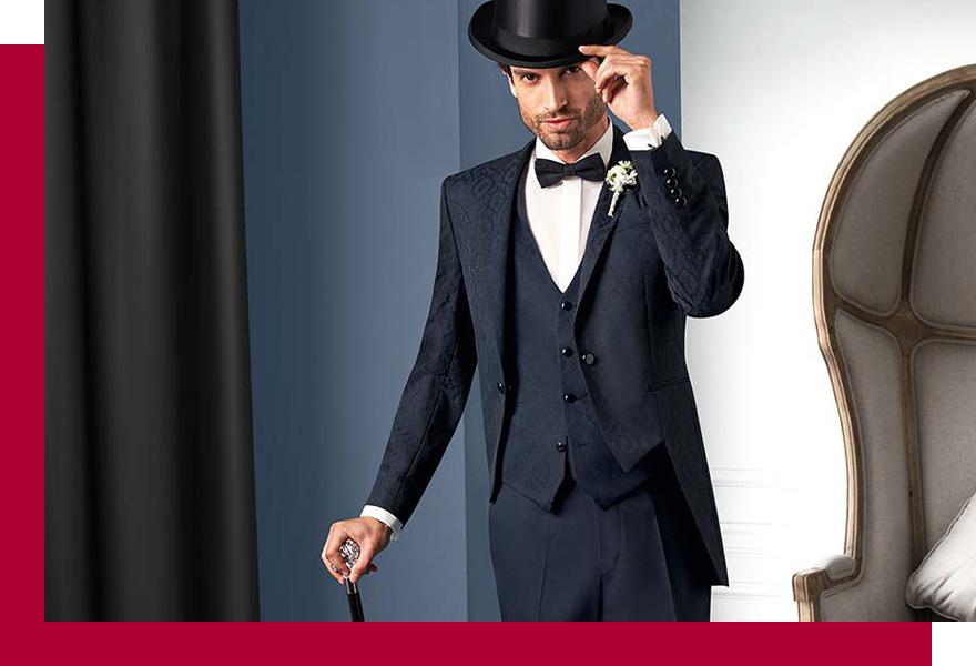 Mann im Anzug mit edlem Sakko und Hut bei Brand-Moden Leidersbach, Anzüge Wiesbaden